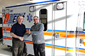 Marshall's Ambulance in St. Walburg, SK, adds a new Crestline Ford FleetMax to its fleet. Gordon Marshall seen here picking up the keys to his new ambulance from Crestline's, Matt Gibson.