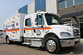 Custom-built pediatric ambulance for Saskatchewans children, built on a Freightliner chassis with two gas tanks.