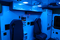 Ambulance interior lighting with clear or blue options to provide ambience and patient comfort during transports.