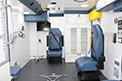 Paramedic seating and medic controls with multiple O2 & medical air port locations. A monitor so children are able to watch movies during travel.